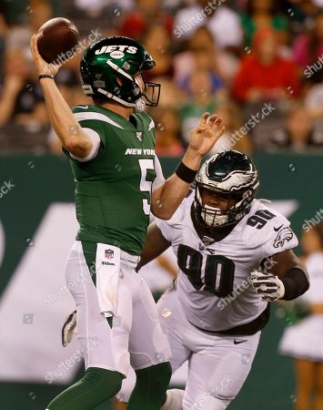 Stock Photo of New York Jets quarterback Davis Webb attempts a pass under pressure from Philadelphia Eagles defensive tackle Treyvon Hester during a preseason NFL football game game, in East Rutherford, N.J