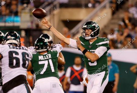 New York Jets quarterback Davis Webb (5) throws a pass against the Philadelphia Eagles during a preseason NFL football game, in East Rutherford, N.J