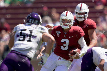 Stanford quarterback K.J. Costello (3) scrabbles out of the pocket against Northwestern linebacker Blake Gallagher (51) during the first half of an NCAA college football game, in Stanford, Calif
