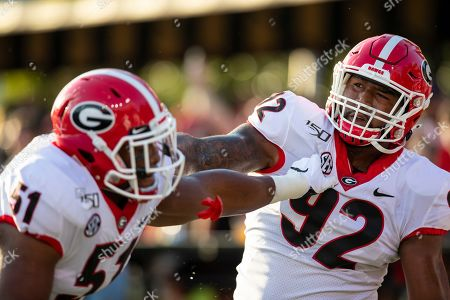 Georgia Bulldogs linebacker David Marshall (51) and defensive end Justin Young (92) warms up before the game against the Vanderbilt Commodores during an NCAA football game on in Nashville, Tenn