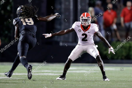 Stock Image of Georgia defensive back Richard LeCounte (2) follows Vanderbilt wide receiver Chris Pierce (19) in the first half of an NCAA college football game, in Nashville, Tenn