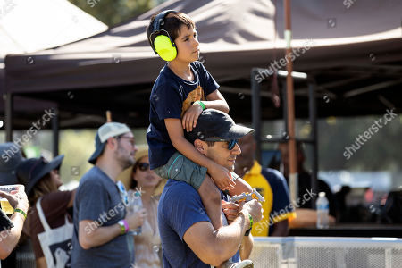 A child listens while sitting on his father's shoulders as Mogwai performs on stage during the Daydream Festival at the Rose Bowl in Pasadena, California, USA, 31 August 2019. The festival only runs for one day.