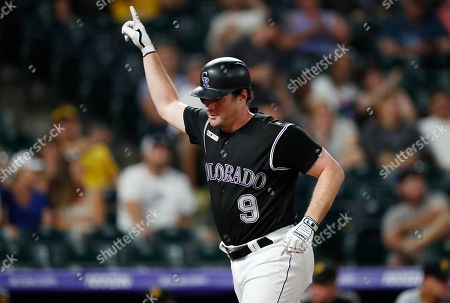 R m. Colorado Rockies' Daniel Murphy crosses home plate after hitting a solo home run off Pittsburgh Pirates relief pitcher Parker Markel in the eighth inning of a baseball game, in Denver