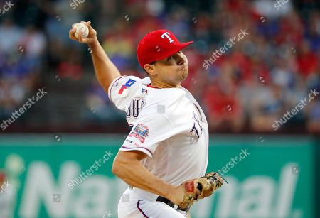Texas Rangers starting pitcher Brock Burke throws to the Seattle Mariners in the first inning of a baseball game in Arlington, Texas