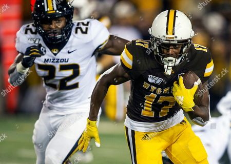 Wyoming receiver Raghib Ismail Jr. (17) runs for yardage as Missouri's Aubrey Miller (22) pursues him in the fourth quarter during an NCAA college football game, in Laramie, Wyo