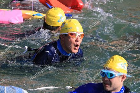 Stock Photo of Former Taiwan President Ma Ying-jeou (C) swims across a lake during the Sun Moon Lake Swimming Carnival in Nantou county, Taiwan, 01 September 2019. Around 23,000 participants join the 3,000 meter long swimming carnival from different age groups and nationalities. In Taiwanese tradition, swimming across Sun Moon Lake is one of the three things one must do in ones lifetime, including a bike ride around Taiwan and climbing the Jade Mountain (Yushan).