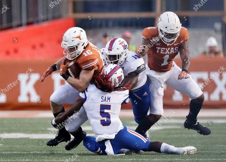 Jake Smith, Michael Sam. Texas wide receiver Jake Smith (16) is hit by Louisiana Tech cornerback Michael Sam (5) during the first half of an NCAA college football game, in Austin, Texas