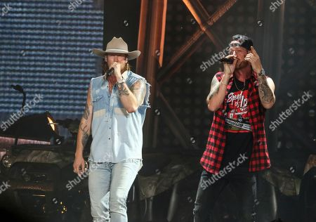 Brian Kelley, Tyler Hubbard. Brian Kelley and Tyler Hubbard with Florida Georgia Line performs during the Can't Say I Ain't Country Tour at Cellairis Amphitheatre at Lakewood, in Atlanta