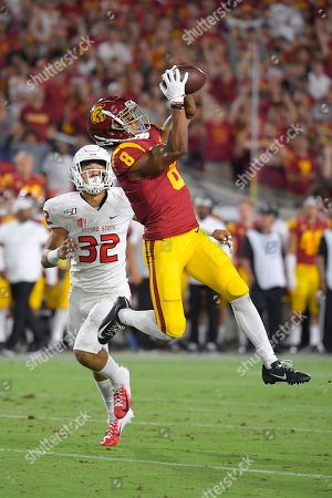 Amon-Ra St. Brown, Evan Williams. Southern California wide receiver Amon-Ra St. Brown, right, makes a catch as Fresno State defensive back Evan Williams watches during the first half of an NCAA college football game, in Los Angeles. The catch was called back due to a penalty against USC