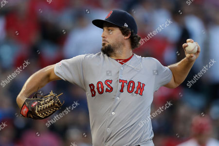 Boston Red Sox pitcher Josh Taylor plays during the first inning of a baseball game against the Los Angeles Angels in Anaheim, Calif