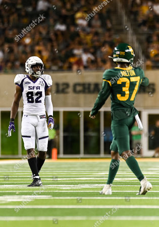 Stephen F. Austin Lumberjacks wide receiver Cody Williams (82) lines up against Baylor Bears cornerback Mark Milton (37) during the 2nd half of the NCAA Football game between Stephen F. Austin Lumberjacks and the Baylor Bears at McLane Stadium in Waco, Texas