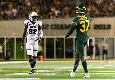 Stock Photo of Stephen F. Austin Lumberjacks wide receiver Cody Williams (82) lines up against Baylor Bears cornerback Mark Milton (37) during the 2nd half of the NCAA Football game between Stephen F. Austin Lumberjacks and the Baylor Bears at McLane Stadium in W, Texas