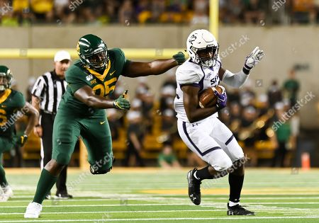 Baylor Bears defensive tackle Gabe Hall (95) ties to tackle Stephen F. Austin Lumberjacks wide receiver Cody Williams (82) during the 2nd half of the NCAA Football game between Stephen F. Austin Lumberjacks and the Baylor Bears at McLane Stadium in W, Texas