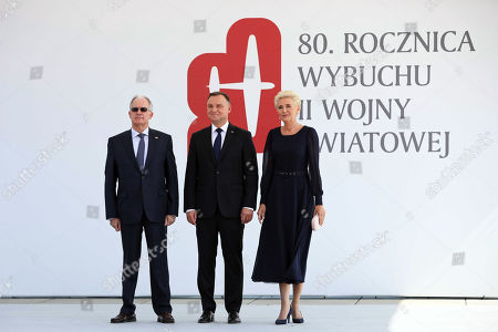 Polish President Andrzej Duda (C) and his wife Agata Kornhauser-Duda (R) welcome Greek Speaker of Parliament Konstantinos Tasoulas (L) during official welcome ceremony at the Jozef Pilsudski Square for the ceremony marking 80th anniversary of World War II outbreak in Warsaw, Poland, 01 September 2019. The Luftwaffe attack on the Polish city of Wielun in the early morning of 01 September 1939 marked the beginning of World War II. A few minutes later, the German battleship SMS Schleswig-Holstein bombarded the Gdansk Westerplatte.