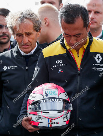 French Formula One driver Alain Prost (L) and teammates of late French Formula 2 driver Anthoine Hubert hold his helmet during a minute of silence to pay tribute, at the Spa-Francorchamps race track in Stavelot, Belgium, 01 September 2019. French driver Anthoine Hubert has died after a high-speed collision on lap two of the Formula 2 race at the Belgian Grand Prix on 31 August.