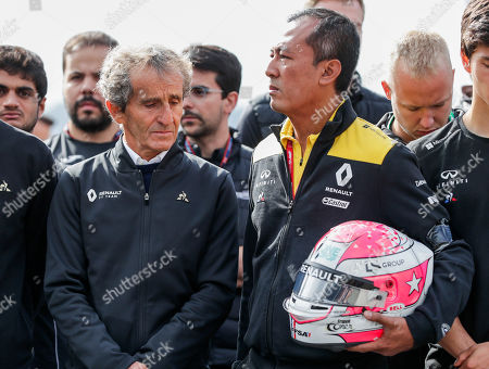 Mia Sharizman (R), Renault Sport Academy Director and former French Formula One driver Alain Prost (L) hold Anthoine Hubert's helmet during a minute of silence to pay tribute to Hubert, at the Spa-Francorchamps race track in Stavelot, Belgium, 01 September 2019. French driver Anthoine Hubert has died after a high-speed collision on lap two of the Formula 2 race at the Belgian Grand Prix on 31 August.