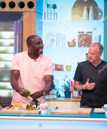 Stock Picture of Linford Christie and Tim Lovejoy