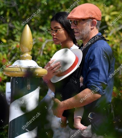 Vincent Cassel (R), his wife Tina Kunakey and their son leave the Lido Beach for the 76th annual Venice International Film Festival, in Venice, Italy, 01 September 2019. The festival runs from 28 August to 07 September.