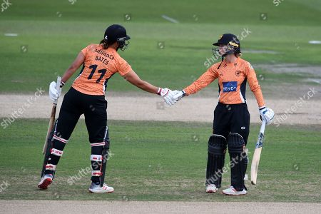 Suzie Bates and Danielle Wyatt of Southern Vipers shake hands on reaching the 50 run partnership during the Kia Women's Cricket Super League semi-final match between Loughborough Lightning and Southern Vipers at the 1st Central County Ground, Hove
