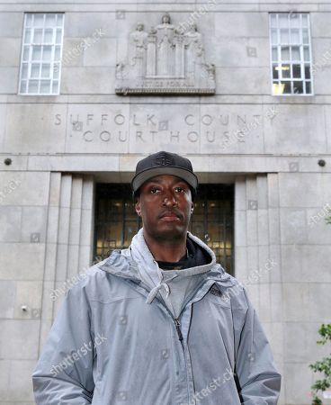 Stock Photo of Sean Ellis poses for a photo outside the Suffolk County Superior Court House in Boston. During the 22 years he spent in prison after being convicted of killing a Boston police detective, Ellis believed there was something suspicious about the officers who led the murder investigation. He just couldn't prove it. It would take years of digging and scores of public information requests from his attorneys to uncover evidence that several officers investigating the 1993 murder case were involved in criminal activity, information that wasn't shared with the defense