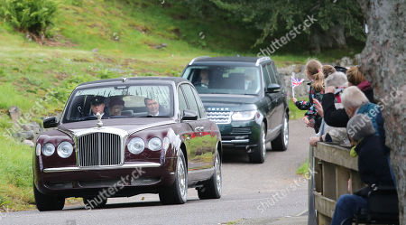 Princess Anne and Tim Laurence accompany Queen Elizabeth II to Crathie Church today