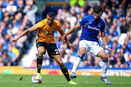 Romain Saiss of Wolverhampton Wanderers takes on Andre Gomes of Everton