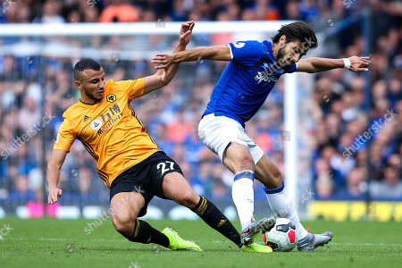Romain Saiss of Wolverhampton Wanderers tackles Andre Gomes of Everton