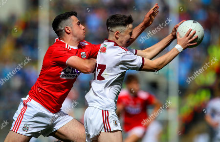 Cork vs Galway . Cork's Joseph O'Shea with Nathan Grainger of Galway