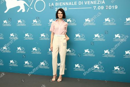 Yuliya Snigir poses for photographers at the photo call for the film 'The New Pope' at the 76th edition of the Venice Film Festival in Venice, Italy