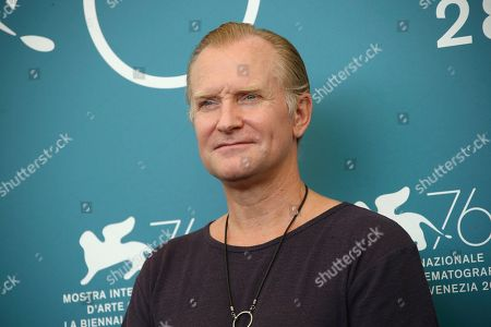 Ulrich Thomsen poses for photographers at the photo call for the film 'The New Pope' at the 76th edition of the Venice Film Festival in Venice, Italy