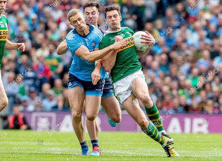Dublin vs Kerry. Dublin's Paul Mannion and Michael Darragh Macauley with David Moran of Kerry