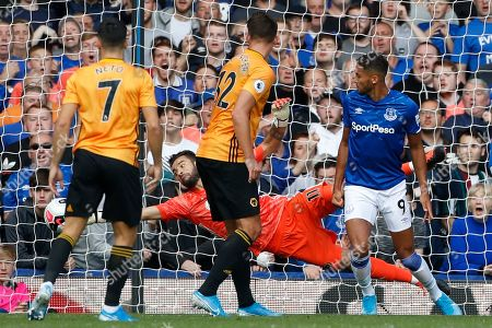 Wolverhampton Wanderers' goalkeeper Rui Patricio saves a shot during the English Premier League soccer match between Everton and Wolverhampton Wanderers at Goodison Park in Liverpool, England