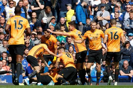 Wolverhampton Wanderers players celebrate after Romain Saiss scored his side's opening goal during the English Premier League soccer match between Everton and Wolverhampton Wanderers at Goodison Park in Liverpool, England