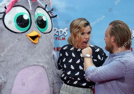 German voice actors Axel Stein (R) and Anke Engelke attend the German premiere of the movie 'Angry Birds 2' in Berlin, Germany, 01 September 2019.