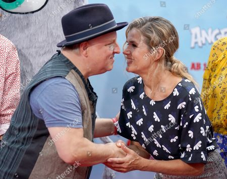 German voice actors Axel Prahl (L) and Anke Engelke attend the German premiere of the movie 'Angry Birds 2' in Berlin, Germany, 01 September 2019.
