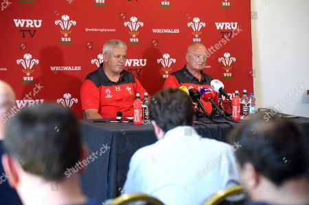 Warren Gatland and team manager Alan Phillips talk to media.