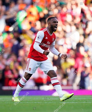 Arsenal's Alexandre Lacazette celebrates after scoring his team's first goal during the English Premier League soccer match between Arsenal FC and Tottenham Hotspur in London, Britain, 01 September 2019.