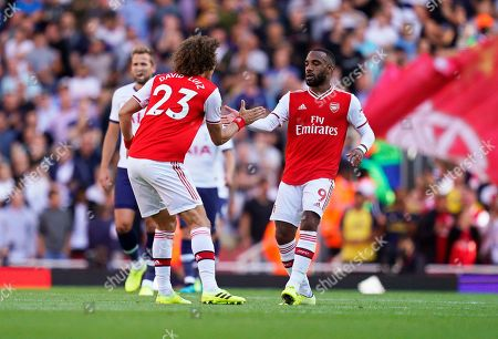 Arsenal's Alexandre Lacazette (R) celebrates with his teammate David Luiz (L) after scoring his team's first goal during the English Premier League soccer match between Arsenal FC and Tottenham Hotspur in London, Britain, 01 September 2019.