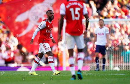 Arsenal's Alexandre Lacazette (L) reacts after scoring his team's first goal during the English Premier League soccer match between Arsenal FC and Tottenham Hotspur in London, Britain, 01 September 2019.