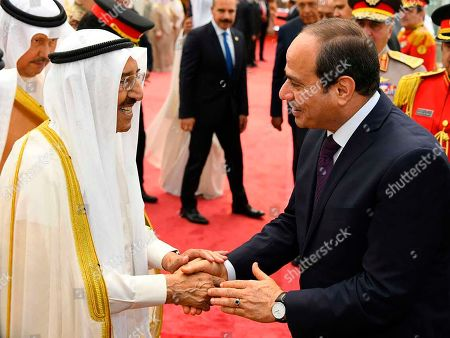 """Abdel-Fattah el-Sissi, Sabah Al Ahmad Al Sabah. In this photo provided by the Egyptian Presidency Media Office, Egyptian President Abdel-Fattah el-Sissi, right, shakes hands with Sheikh Sabah Al Ahmad Al Sabah, Kuwait's 90-year-old ruling emir in Kuwait city, Kuwait, . On Aug. 18, Kuwait acknowledged the emir suffered an unspecified medical """"setback"""