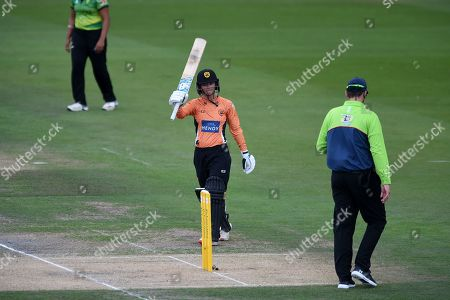 Danielle Wyatt of Southern Vipers raises her bat on reaching his half-century during the Kia Women's Cricket Super League Final match between Western Storm and Southern Vipers at the 1st Central County Ground, Hove
