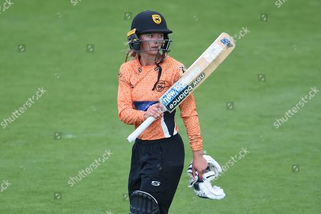 Danielle Wyatt of Southern Vipers raises her bat as she  walks off after being dismissed for 73 during the Kia Women's Cricket Super League Final match between Western Storm and Southern Vipers at the 1st Central County Ground, Hove