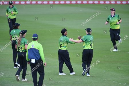 Deepti Sharma and Heather Knight of Western Storm celebrate the wicket of Danielle Wyatt during the Kia Women's Cricket Super League Final match between Western Storm and Southern Vipers at the 1st Central County Ground, Hove