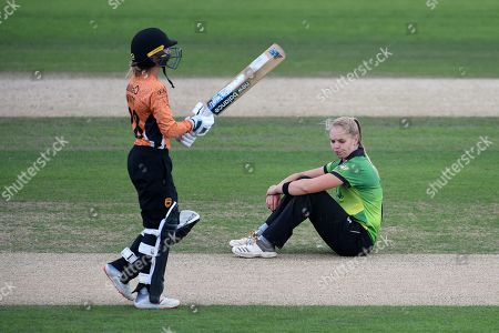 Freya Davies of Western Storm sits on the floor as Danielle Wyatt finds the boundary during the Kia Women's Cricket Super League Final match between Western Storm and Southern Vipers at the 1st Central County Ground, Hove