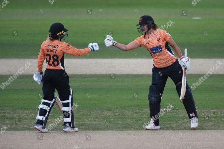 Danielle Wyatt and Suzie Bates of Southern Vipers bring up the 50 run partnership during the Kia Women's Cricket Super League Final match between Western Storm and Southern Vipers at the 1st Central County Ground, Hove