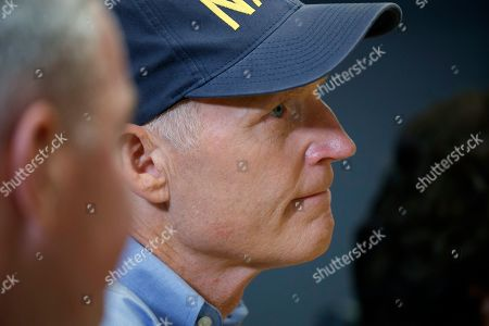 Sen. Rick Scott, R-Fla., listens as President Donald Trump speaks during a briefing about Hurricane Dorian at the Federal Emergency Management Agency (FEMA), in Washington