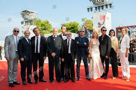 Tomas Arana, Javier Camara, Paolo Sorrentino, John Malkovich, Maurizio Lombardi, Massimo Ghini, Ludivine Sagnier, Jude Law, Yuliya Snigir, Cecile de France. Actors Tomas Arana, from left, Javier Camara, director Paolo Sorrentino, actors Maurizio Lombardi, Silvio Orlando, Massimo Ghini, Ludivine Sagnier, Jude Law, Yuliya Snigir and Cecile de France pose for photographers upon arrival at the premiere of the film 'The New Pope' at the 76th edition of the Venice Film Festival, Venice, Italy