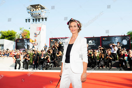 Cecile de France poses for photographers upon arrival at the premiere of the film 'The New Pope' at the 76th edition of the Venice Film Festival, Venice, Italy