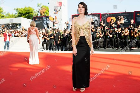 Yuliya Snigir poses for photographers upon arrival at the premiere of the film 'The New Pope' at the 76th edition of the Venice Film Festival, Venice, Italy