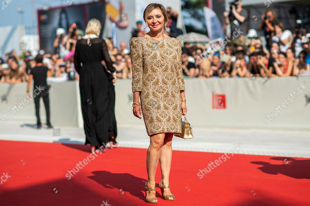 Stock Photo of Silvia Damiani poses for photographers upon arrival at the premiere of the film 'The New Pope' at the 76th edition of the Venice Film Festival, Venice, Italy